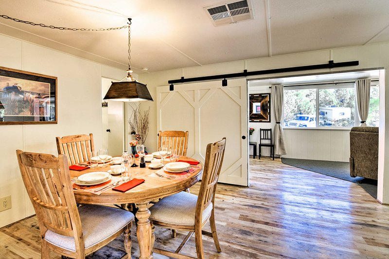 A chic barn door separates the dining area & kitchen from the living room.
