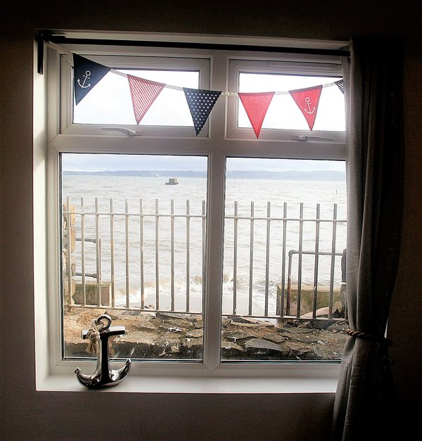The view from the Boat House window - spend all day looking at the sea.