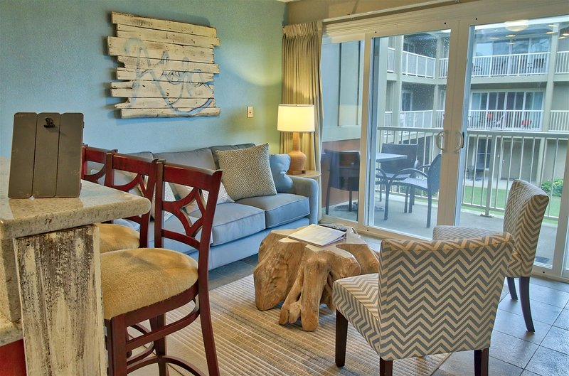 This second-floor unit offers 2 bedrooms and 1 bath to accommodate up to 4.
