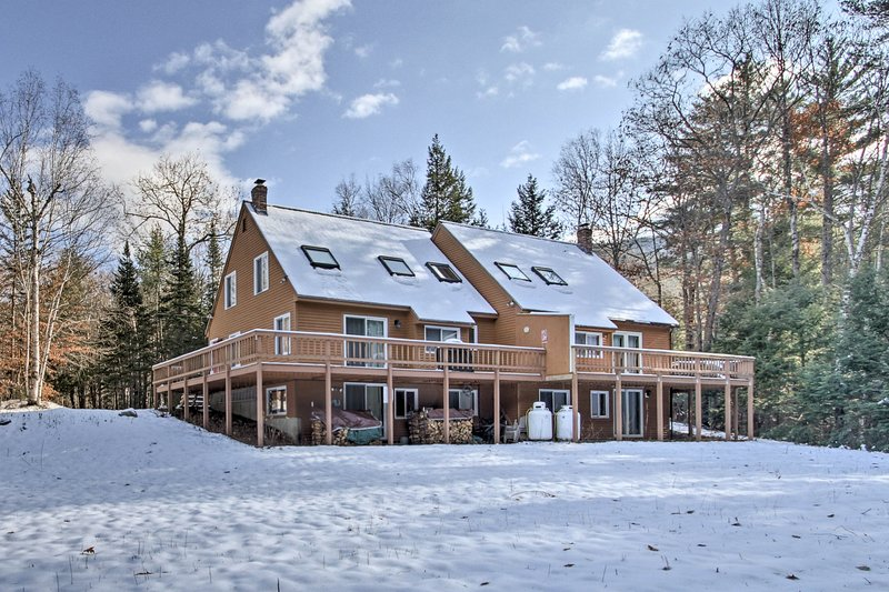 The vacation rental boasts a wraparound deck and forested seclusion.