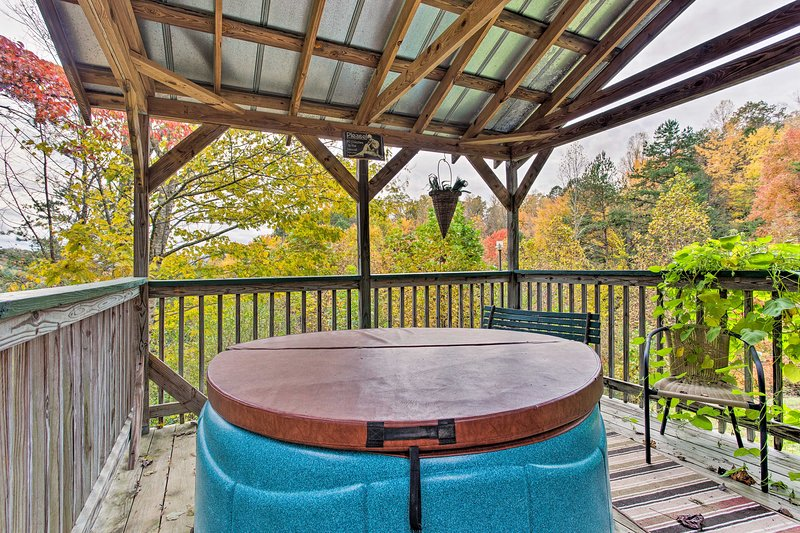 Up to 6 lucky guests can enjoy the private covered hot tub and mountain views.