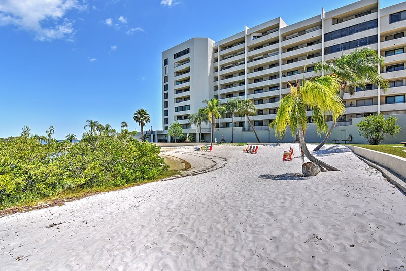 The vacation rental provides access to numerous amenities including this beach!