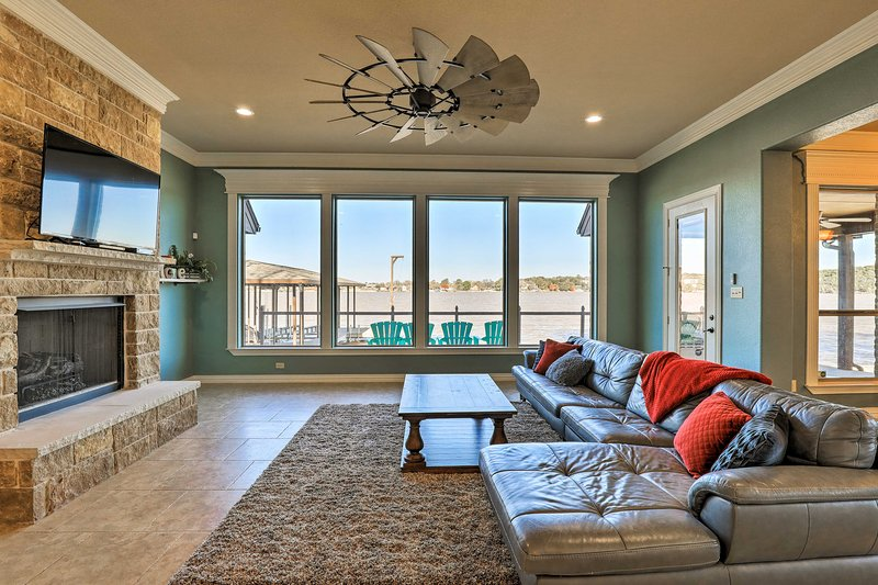 Relax at the 'Granbury Lodge,' a 3-bed, 2.5-bath lakefront home with a boat dock