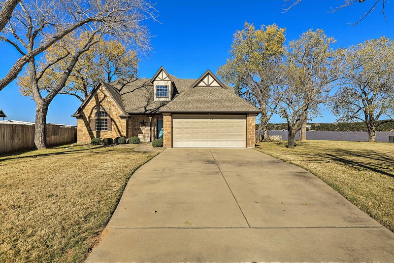 The 'Granbury Lodge' has plenty of space for yard games and lakefront games.