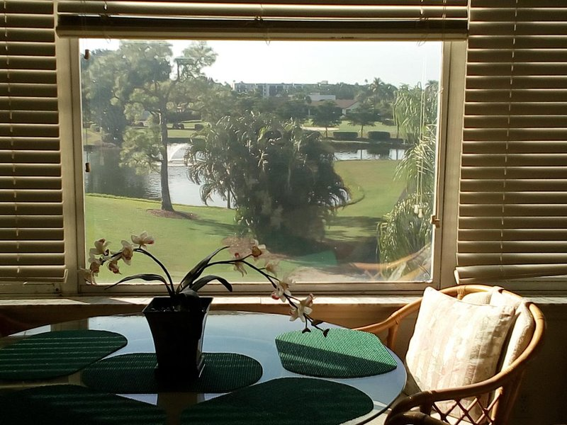 View of the lake and golf course from the dining areq