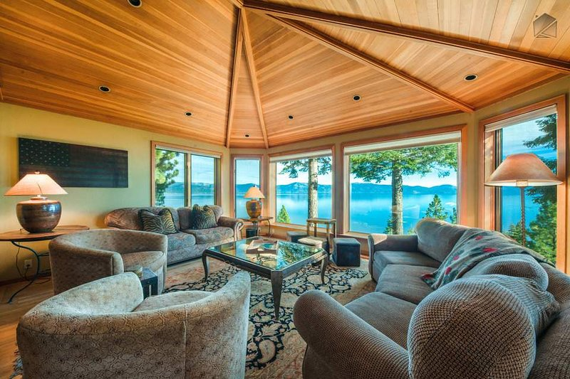 Enjoy expansive views of Lake Tahoe from a comfortable seat in the main living room