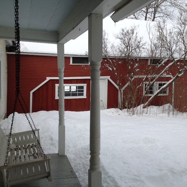 View from Front Porch with Swing looking toward the Red Barn which is a Game Room.