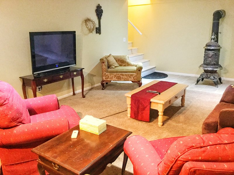 Roomy living room with comfortable furniture and dimmable lighting for nice ambiance.