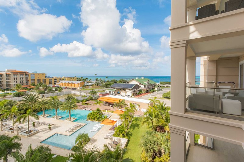 Enjoy the tranquility with views of Eagle Beach and the luscious tropical landscaping