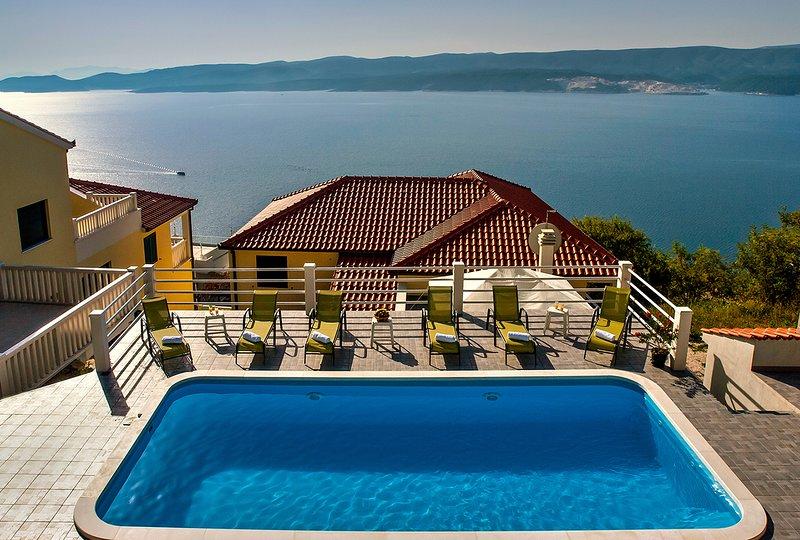 View from the pool toward villa and beautiful view toward island Brac