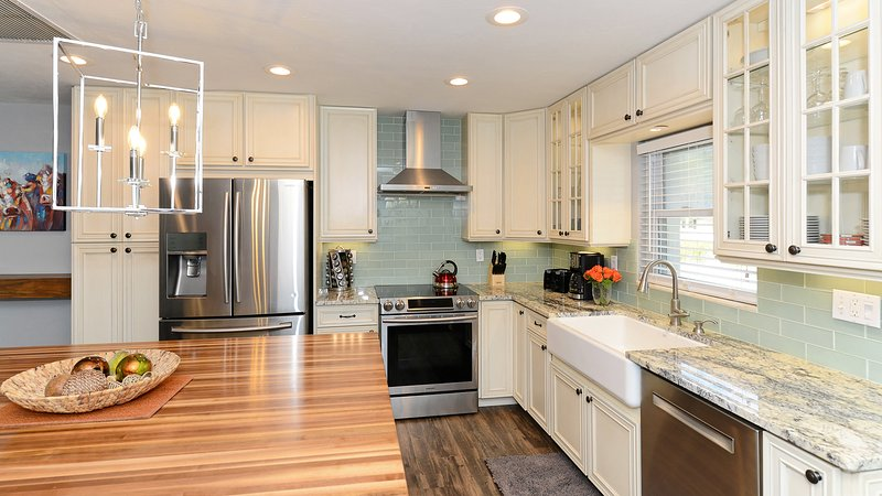 kitchen with all new appliances and a farmhouse sink