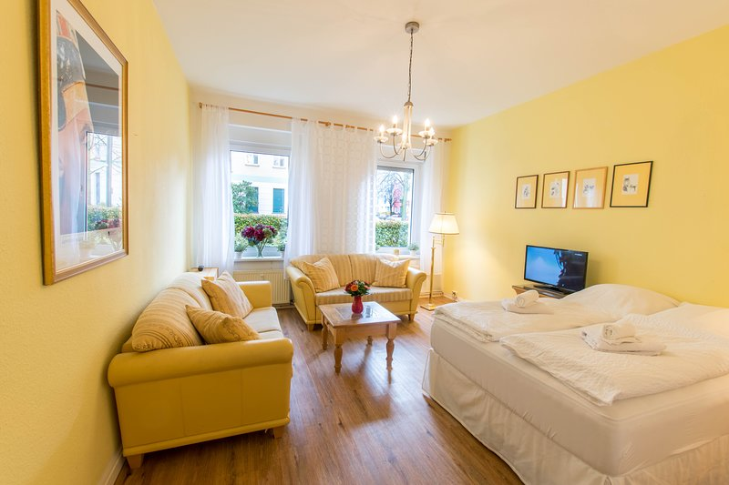 comfortable seating area with cable TV and wonderful queensize bed in large bedroom