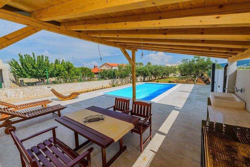 Patio with gazebo,  pool free to use