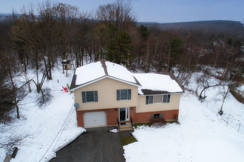 Vacation home aerial view during winter season