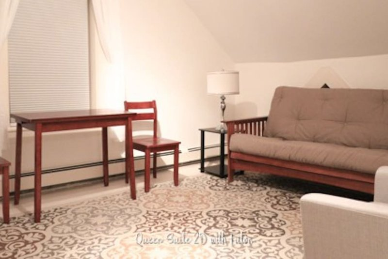 Sitting room in Suite with Futon, Queen bed in attached Bedroom