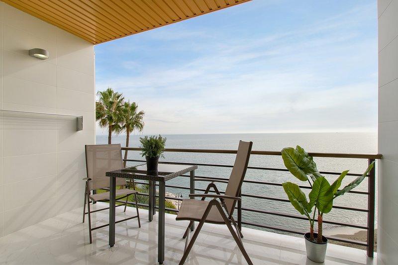 Vista desde el balcón. Paseo marítimo.