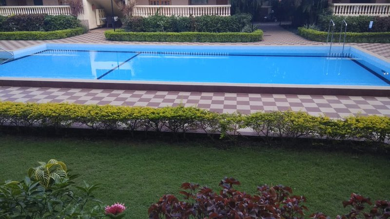 *Amora* POOL View Ground Floor, Candolim, holiday rental in Marra