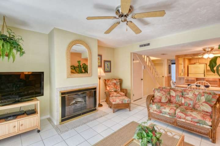 The family room is fitted with large flat screen TV and gas log fireplace.