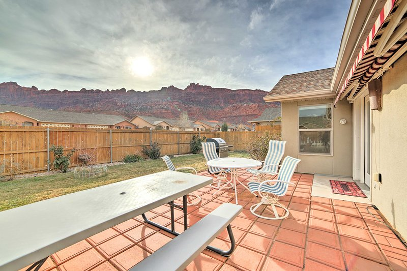 Marvel at the mountains from your vacation rental's private patio and yard!