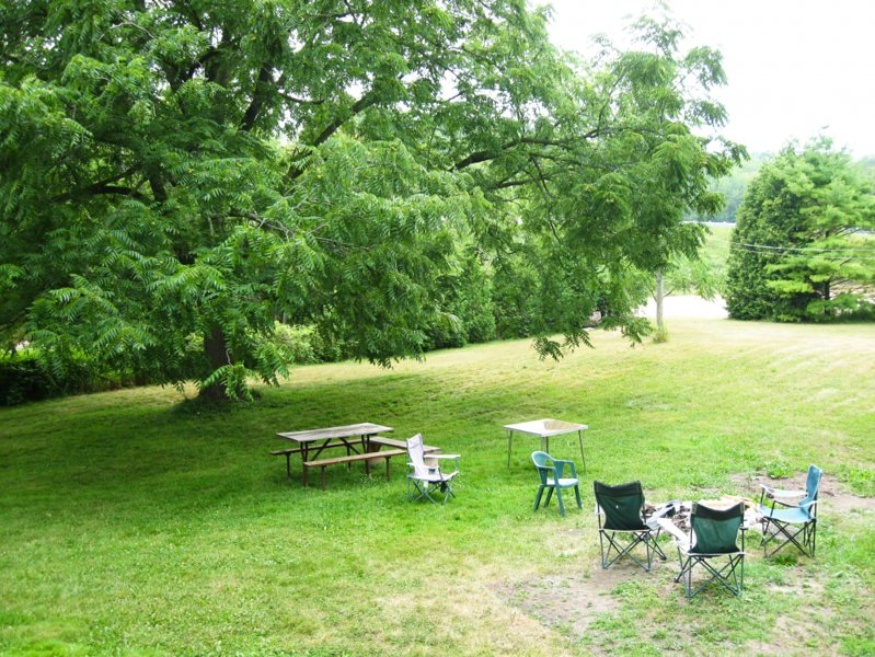 Large yard with fire pit.  Free camp fire wood.