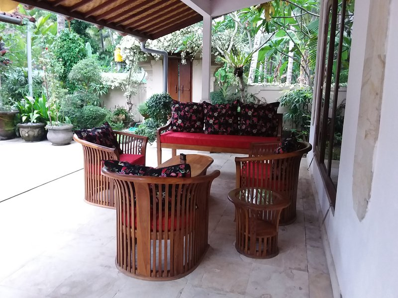 Outdoor seating with wall fan