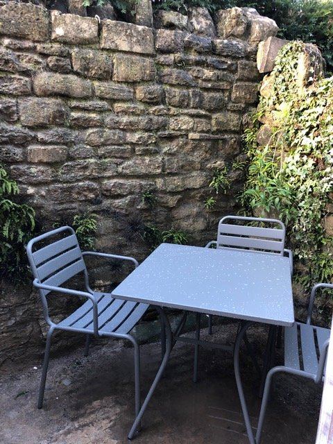 private courtyard has seating for four