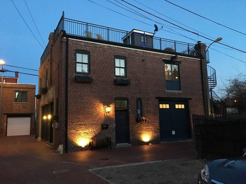 The Old Ledroit Park Fire Station at night. Lower level apartment of two lofts. Garden only