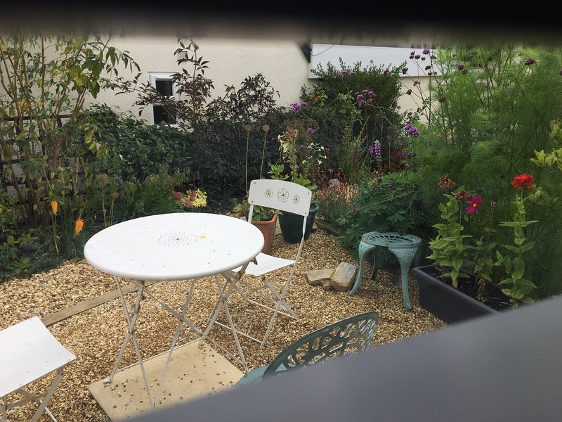 The Dovecote patio garden with table and chairs