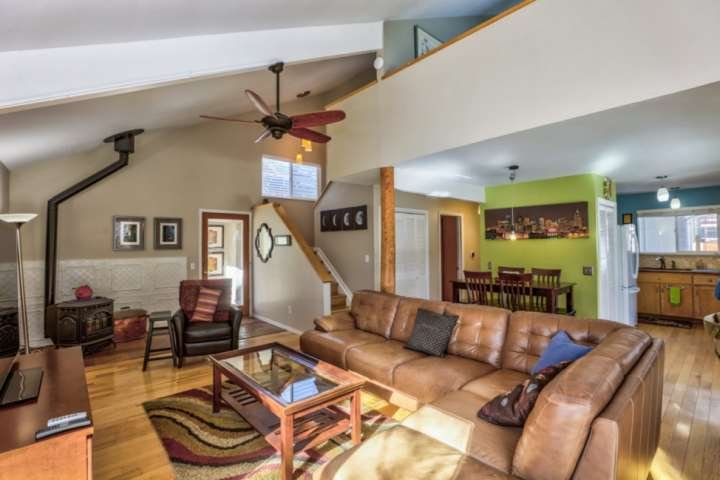 Main level open floor plan, perfect for relaxing in front of TV, reading a book, or spending time with friends and family.