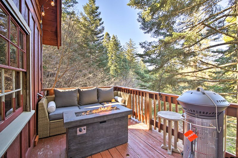Evenings are best spent outdoors on the spacious deck with a gas grill.