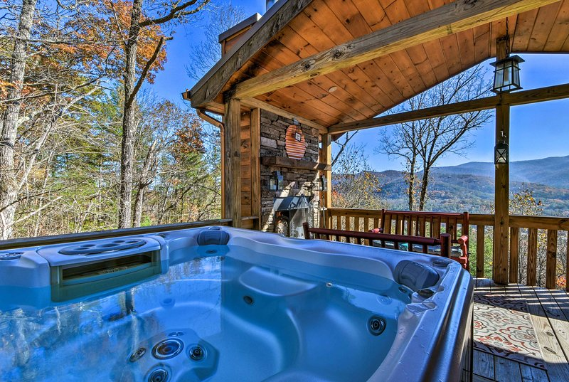 Soak up the fresh mountain air and marvel at the view in the private hot tub.