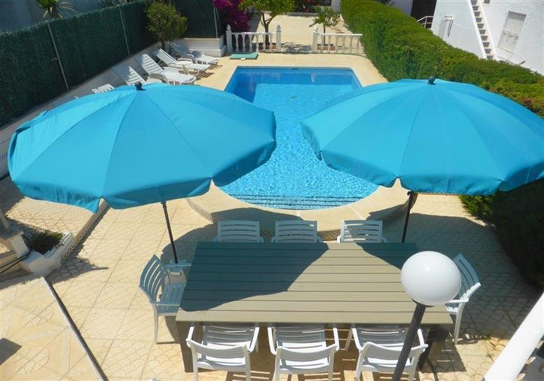 Private swimming pool with eating and sunbathing area