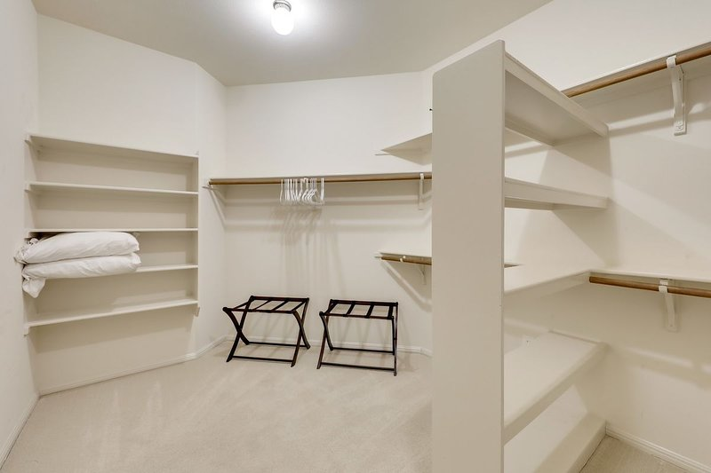 ENORMOUS CLOSETS:  Bedrooms have enormous walk-in closets with hangars, luggage stands, extra pillows and blankets