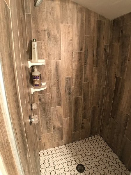 Freshly retiled shower with organic bath products