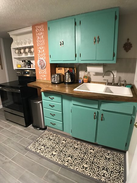 Cottage kitchen with new SS appliances and live edge pine counter and vintage farmhouse sink