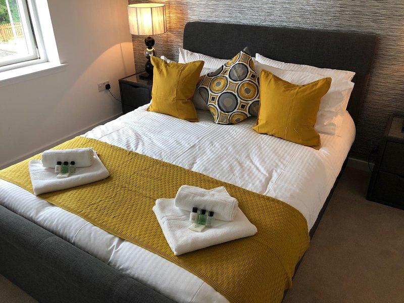 Hoofdslaapkamer met kingsize bed