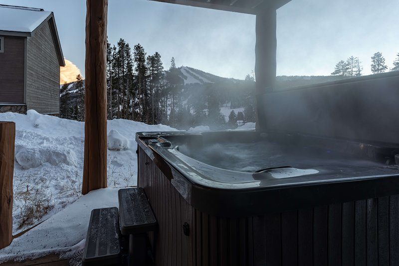 Keep warm with a steamy soak in the private hot tub