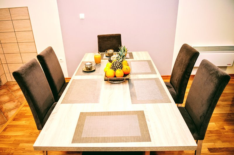a dining table with 6 chairs