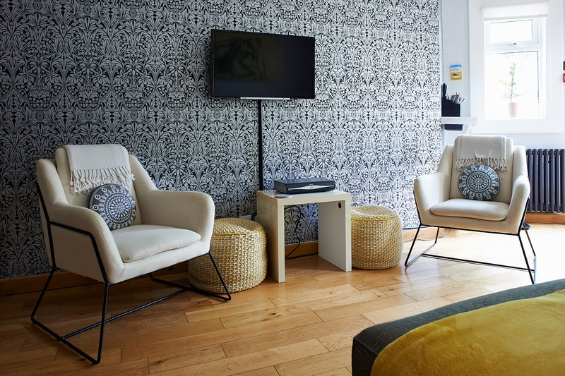 Newly added contemporary chairs and extra floor cushions adding a hint of yellow.