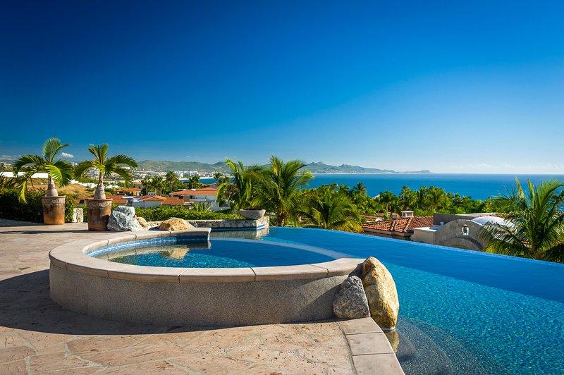 Take a quick swim through the villa's spacious infinity pool
