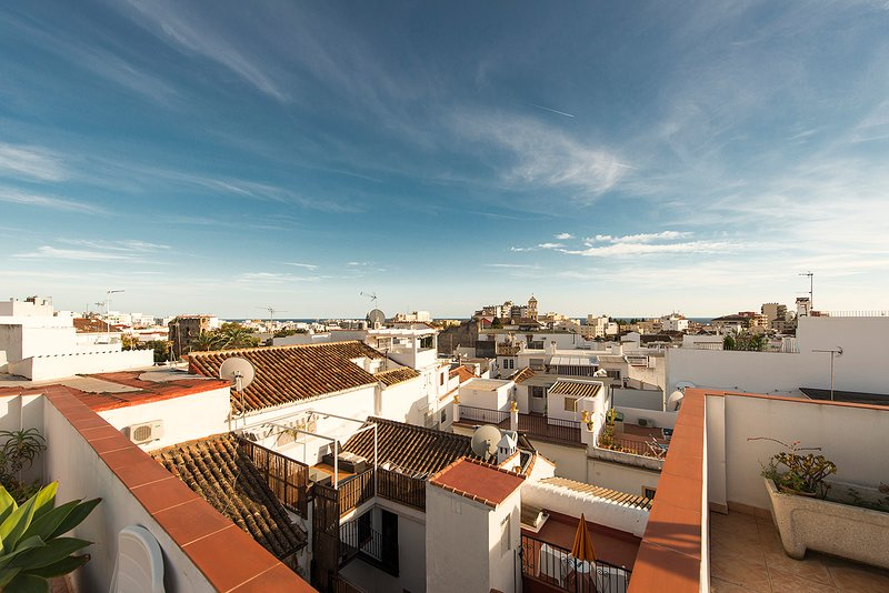 The delightful roof terrace with views of the Old Town and the surrounding mountains.