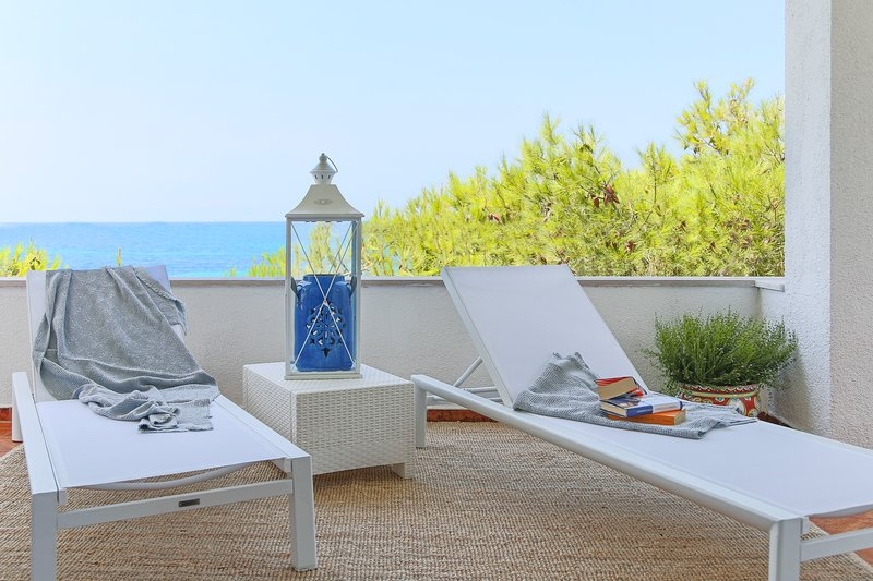 Terrace with the sun loungers and table