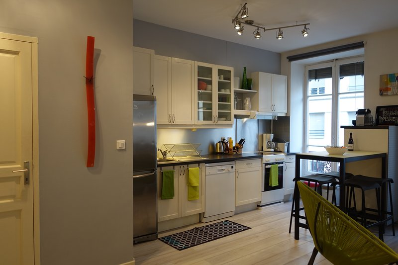 a very equipped and bright kitchen area