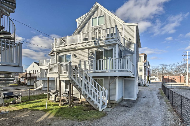 This beachy condo boasts a location just steps from the shore!