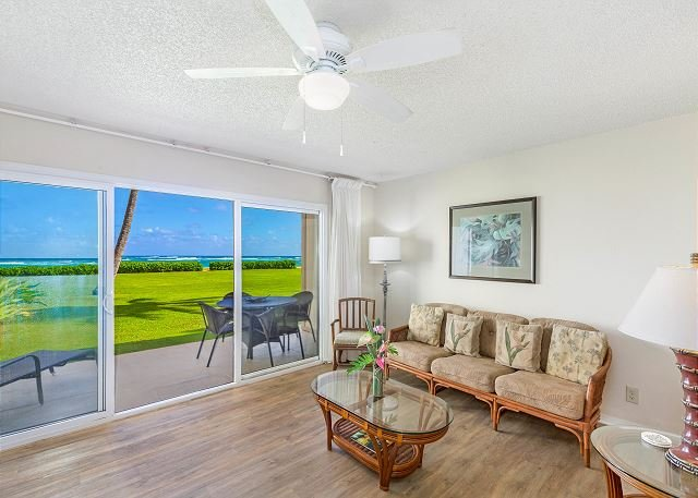 Oceanfront Living Area with Large Flat Screen TV & Ceiling Fan