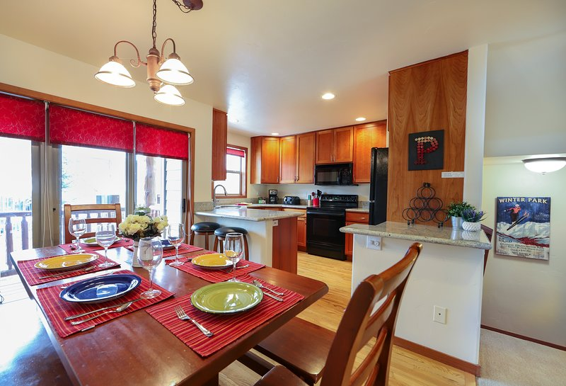Dining area with an open floor plan to the kitchen and living room makes entertaining a family event!