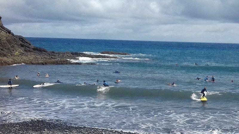surfing at Porto da Cruz beach  a few minutes walk away