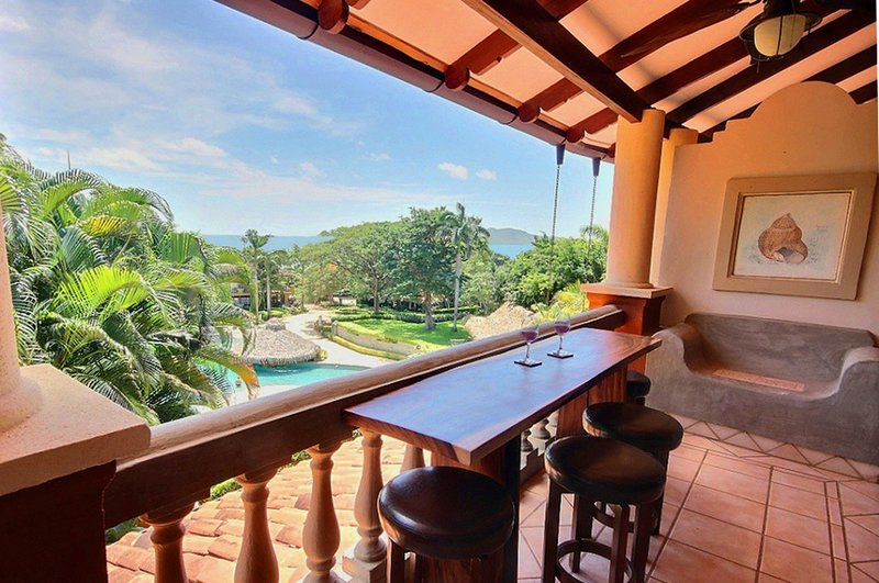 Tamarindo Diria 202 - Ocean view condo with custom bar on the terrace!