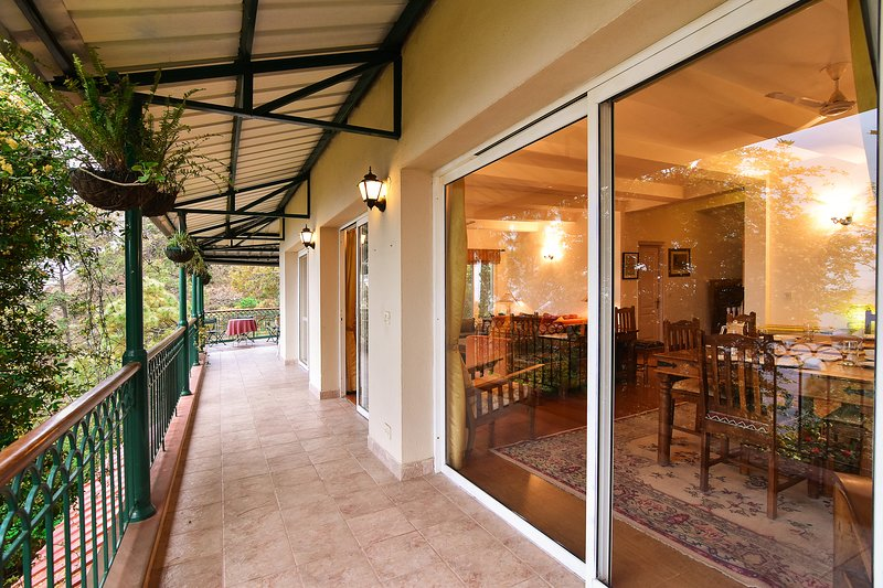 The open verandah connects to the wooden deck and has beautiful views of the valley