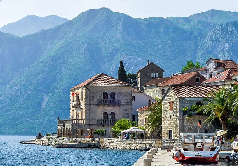 Perast nestled beneath 2 massiifs of the Dinaric Alps